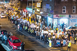 © Licensed to London News Pictures . 22/02/2018 . Manchester , UK . The march passes through Rusholme . 100s of protesters , campaigning against the sexual harassment, abuse, rape and victim-blaming suffered by women, hold a Reclaim the Night march and rally from Owens Park in Fallowfield to the Manchester Academy on Oxford Road . Photo credit : Joel Goodman/LNP