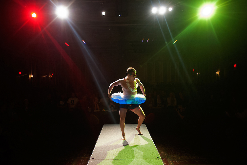 Hunter Brett walks the catwalk during the swimsuit portion of the first annual Mr. University Pageant. The pageant, which was organized by Alpha Delta Pi was held as a fundraiser for the Ronald McDonald House Charities of central Ohio and featured 19 male students who competed in swimsuit, OU trivia and formal wear contests. Photo by: Ross Brinkerhoff.