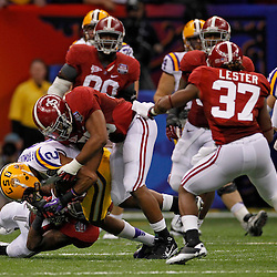 Jan 9, 2012; New Orleans, LA, USA; Alabama Crimson Tide linebacker Nico Johnson (35) tackles LSU Tigers wide receiver Rueben Randle (2) during the first half of the 2012 BCS National Championship game at the Mercedes-Benz Superdome.  Mandatory Credit: Derick E. Hingle-US PRESSWIRE