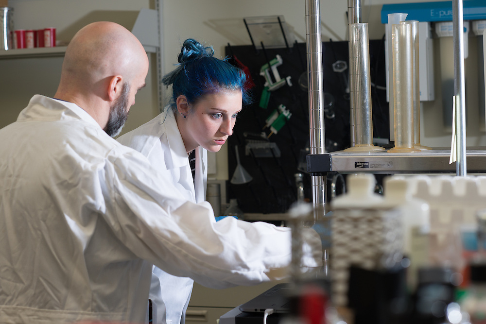 Ronan Carroll (Left), Assistant Professor in the department of Biological Sciences, works with lab student Nikki Meyer. © Ohio University/ Photo by Ben Siegel