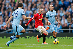 Wayne Rooney of Manchester United is challenged by Martin Demichelis and Pablo Zabaleta of Manchester City - Photo mandatory by-line: Rogan Thomson/JMP - 07966 386802 - 02/11/2014 - SPORT - FOOTBALL - Manchester, England - Etihad Stadium - Manchester City v Manchester United - Barclays Premier League.