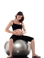 pregnant caucasian woman relaxing sit on fitness ball isolated studio on white background
