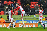 Ben Whiteman of Doncaster Rovers (8) (centre) scores a goal and celebrates, with John Marquis of Doncaster Rovers (9) and Herbie Kane of Doncaster Rovers (15), to make the score 1-0 during the EFL Sky Bet League 1 match between Doncaster Rovers and Scunthorpe United at the Keepmoat Stadium, Doncaster, England on 15 December 2018.