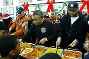 New York, NY- December 25-  l to r: Attorney Michael Hardy, Dominique Sharpton, Rev. Al Sharpton nand Londell McMillian at the Rev. Al Sharpton and National Action Network Feeding of the Hungry on Christmas Day & Toy Giveaway at the Annual NAN Event held at the NAN's House of Justice on December 25, 2011 in Harlem, New York City. Photo Credit: Terrence Jennings