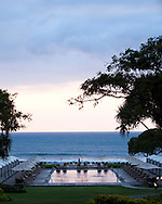 The Four Seasons Resort Hualalai at Historic Kaupulehu on the Big Island of Hawaii. The Beach Tree Pool at sunset.