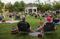 """Jan and Kevin Keady  with their dog """"Ellie"""" sit amongst the crowd enjoying the soulful sound of Sharon """"Sugar"""" Jones during Thursday evenings Concert by the River at Rotary Park.  (Karen Bobotas/for the Laconia Daily Sun)"""