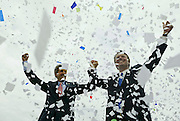 Democratic Presidential candidate Senator John Kerry (D-MA) (L) and Vice Presidential candidate Senator John Edwards (D-NC) are showered in confetti at a rally in Cleveland, Ohio, July 7, 2004. Kerry and Edwards will be formally anointed later this month at the Democratic convention in Boston as the party's challengers to President George W. Bush and Vice President Dick Cheney in the November 2 election. REUTERS/Jim Young