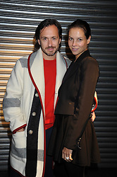 MARC NEWSON and his wife CHARLOTTE STOCKDALE at an exhibition entitled 'Cut Flowers' by Robin Derrick held at 70a Silverthorne Road, London SW8 on 8th October 2008.