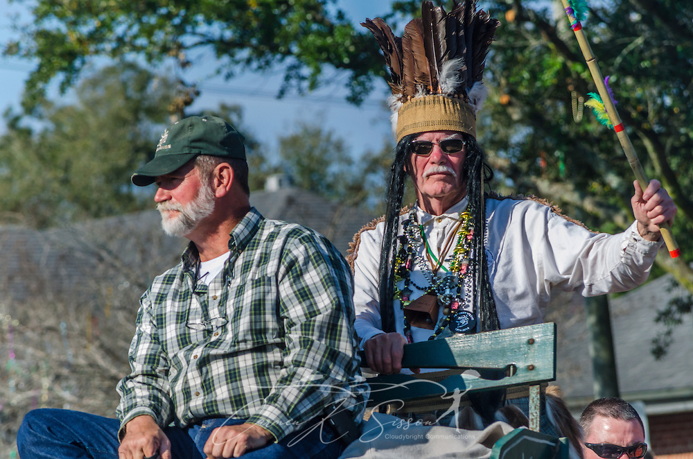 "Fictional Chickasaw Indian Chief Slacabamorinico, portrayed by Wayne Dean, is driven down Washington Street in downtown Mobile, Ala., during the Joe Cain Procession during Mardi Gras, March 2, 2014. The parade, also known as ""The People's Parade,"" celebrates the life of the late Joe Cain, who revived Mardi Gras in Mobile in 1867 after it was temporarily halted by the Civil War. Dean has portrayed the character since 1985. French settlers held the first Mardi Gras in 1703, making Mobile's celebration the oldest Mardi Gras in the United States. (Photo by Carmen K. Sisson/Cloudybright)"