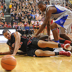 Rutgers Scarlet Knights forward/center Austin Johnson (21) watches a loose ball roll away after diving to catch it during first half Big East NCAA Basketball between the Rutgers Scarlet Knights and Seton Hall Pirates at the Louis Brown Athletic Center. Rutgers leads Seton Hall 28-26 at halftime.