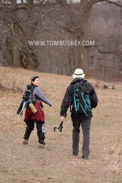 Mountainville, N.Y. - A man and a woman walk back to the trail head after hiking on Schunnemunk Mountain on Feb. 25, 2006..© Tom Bushey/The Image Works