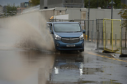 © Licensed to London News Pictures. 01/10/2019. London UK: Motorists driving on the flooded Factory road in North Woolwich, east London close to the cross rail construction site.  Photo credit: Steve Poston/LNP