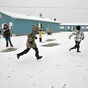 Children play in the yard of the makeshift elementary school, composed of portable classrooms. The previous elementary school building was contaminated with diesel fuel and was closed in 2000. The community has been pleading with the Canadian government for a new school for over a decade. <br /> <br /> (Ian Stewart photo)