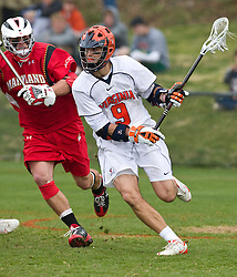 Virginia Cavaliers A Danny Glading (9) in action against UMD.  The #9 ranked Maryland Terrapins fell to the #1 ranked Virginia Cavaliers 10 in 7 overtimes in Men's NCAA Lacrosse at Klockner Stadium on the Grounds of the University of Virginia in Charlottesville, VA on March 28, 2009.