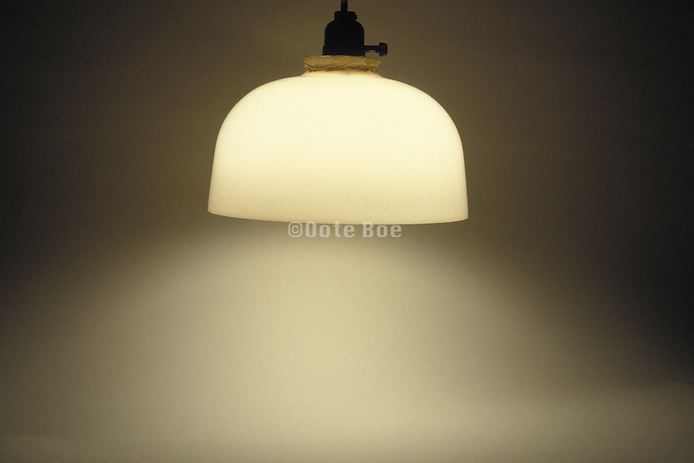 illuminated lamp hanging from ceiling