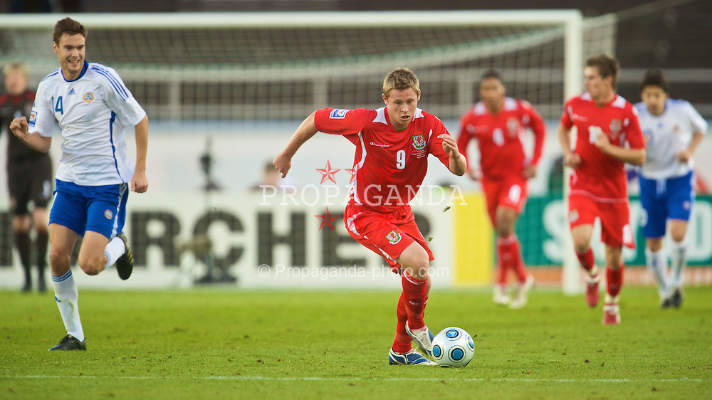 HELSINKI, FINLAND - Saturday, October 10, 2009: Wales' Simon Church in action against Finland during the 2010 FIFA World Cup Qualifying Group 4 match at the Olympic Stadium. (Pic by David Rawcliffe/Propaganda)
