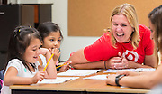 Volunteers from PricewaterhouseCoopers, Target and the Houston Symphony work with students at Benbrook Elementary School during a summer literacy camp sponsored by the Barbara Bush Houston Literacy Foundation, July 19, 2016.