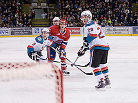 KELOWNA, CANADA, DECEMBER 27: Liam Stewart #11 of the Spokane Chiefs and Cole Martin #8, Shane McColgan #18 and Myles Bell #29 of the Kelowna Rockets look for the puck at the Kelowna Rockets on December 7, 2011 at Prospera Place in Kelowna, British Columbia, Canada (Photo by Marissa Baecker/Getty Images) *** Local Caption ***