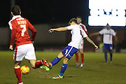 Andrew Tutte of Bury tries a shot during the Sky Bet League 1 match between Bury and Barnsley at The JD Stadium, Bury, England on 23 February 2016. Photo by Simon Brady.