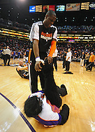 Feb. 17, 2011; Phoenix, AZ, USA; Phoenix Suns guard Mickael Pietrus (12) is stretches the Phoenix Suns Gorilla prior to the game against the Dallas Mavericks at the US Airways Center. Mandatory Credit: Jennifer Stewart-US PRESSWIRE