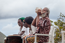"Delroy ""Ital"" Anthony of the Echo People sounds the conch shell before beginning.  The Virgin Islands National Park Service presents the 26th Annual Folk-life Festival ""Celebrating Transfer Day from the Danish West Indies to the United States Virgin Islands""  Annaberg Sugar Plantation Ruins.  23 February 2017.  © Aisha-Zakiya Boyd"