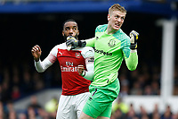 Football - 2018 / 2019 Premier League - Everton vs. Arsenal<br /> <br /> Alexandre Lacazette of Arsenal challenges Everton keeper Jordan Pickford, at Goodison Park.<br /> <br /> COLORSPORT/ALAN MARTIN