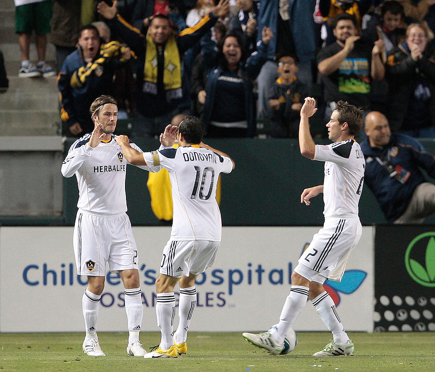 Los Angeles Galaxy forward Landon Donovan (10), celebrates with teammates David Beckham, left, of England and Todd Dunivant (2) after Donovan scored on an assist by Beckham in the first half of a MLS soccer match, Saturday, May 7, 2011, in Carson, Calif. (AP Photo/Jason Redmond)
