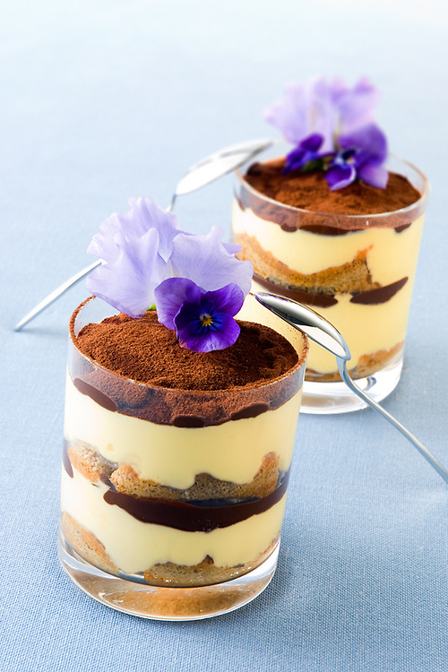 tiramisu in a glass decorated with purple flowers