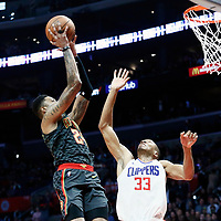 08 January 2018: Atlanta Hawks guard Kent Bazemore (24) takes a jump shot over LA Clippers forward Wesley Johnson (33) during the LA Clippers 108-107 victory over the Atlanta Hawks, at the Staples Center, Los Angeles, California, USA.