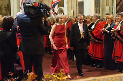 © Licensed to London News Pictures. 14/12/2016. British Prime Minister Theresa May and husband Philip May attend the annual Lord Mayor's Banquet at Guildhall. London, UK. Photo credit: Ray Tang/LNP