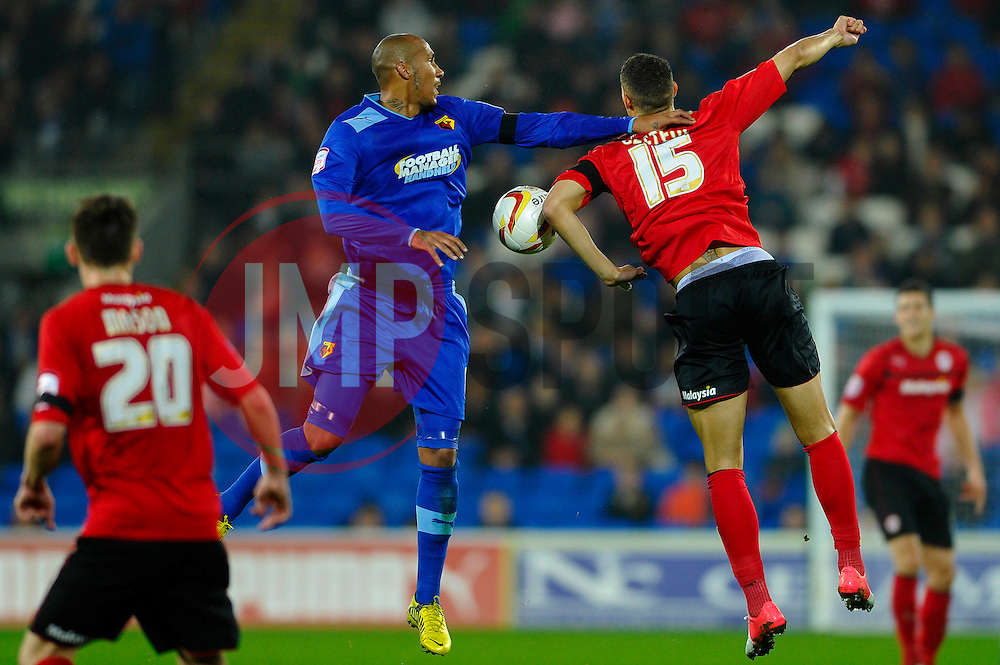 Watford Defender Fitz Hall (ENG) and Cardiff Forward Rudy Gestede (FRA) compete in the air during the second half of the match - Photo mandatory by-line: Rogan Thomson/JMP - Tel: Mobile: 07966 386802 23/10/2012 - SPORT - FOOTBALL - Cardiff City Stadium - Cardiff. Cardiff City v Watford - Football League Championship