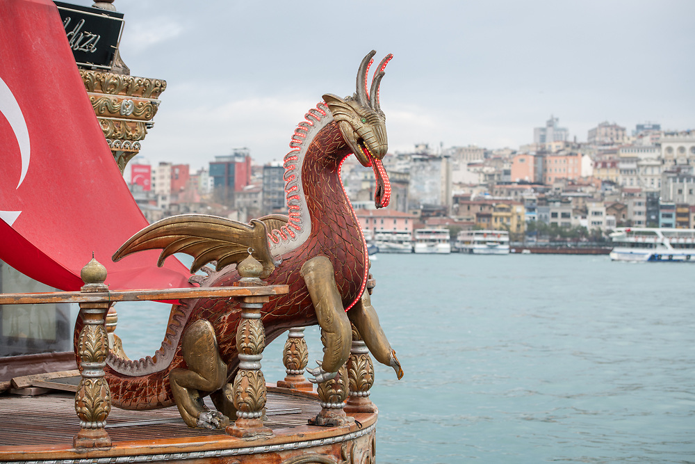 This wooden dragon acts as a figurehead for the bow of ship on the Golden Horn, Istanbul, Turkey.