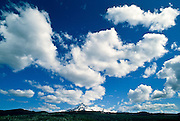 Clouds and blue sky over Three Sisters mountains, Three Sisters Wilderness area, Oregon