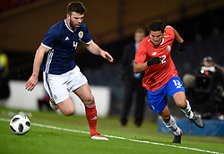 Scotland's Grant Hanley and Costa Rica's Daniel Colindres during the international friendly match at Hampden Park, Glasgow. RESTRICTIONS: Use subject to restrictions. Editorial use only. Commercial use only with prior written consent of the Scottish FA.