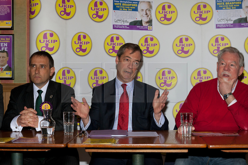 © licensed to London News Pictures. London, UK 12/04/2012. UKIP London Mayoral candidate Lawrence Webb, UKIP Leader Nigel Farage and Richard Bridgeman speaking at the Porters English Restaurant for the launch of London Mayoral election campaign of UKIP. UKIP announced Lawrence Webb as their Mayoral candidate and the campaign is backed by long term Tory supporter Peter Stringfellow. Photo credit: Tolga Akmen/LNP