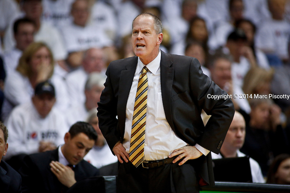 SHOT 1/16/14 7:23:08 PM - Colorado head basketball coach Tad Boyle watches his team play against UCLA during their regular season Pac-12 Conference basketball game at the Coors Events Center in Boulder, Co. UCLA won the game 69-56.<br /> (Photo by Marc Piscotty / &copy; 2014)