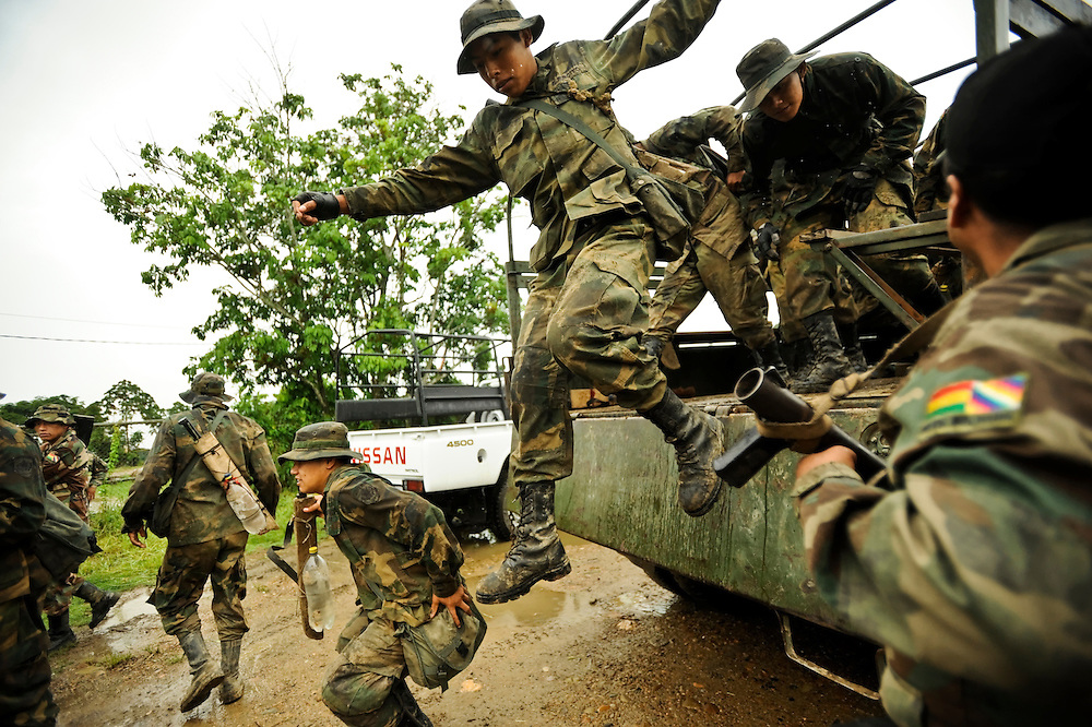 Counternarcotics forces disembark on a patrol to eradicate coca patches that are over the legal limit in the Chapare. It's estimated that 90 percent of coca from the Chapare goes to the drug trade.