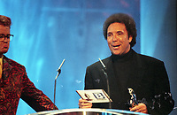 Chris Evans host of The BRIT Awards 1995 and Tom Jones<br /> Monday 20 Feb 1995.<br /> Alexandra Palace, London, England<br /> Photo: JM Enternational<br /> Monday 20 Feb 1995.<br /> Alexandra Palace, London, England<br /> Photo: JM Enternational
