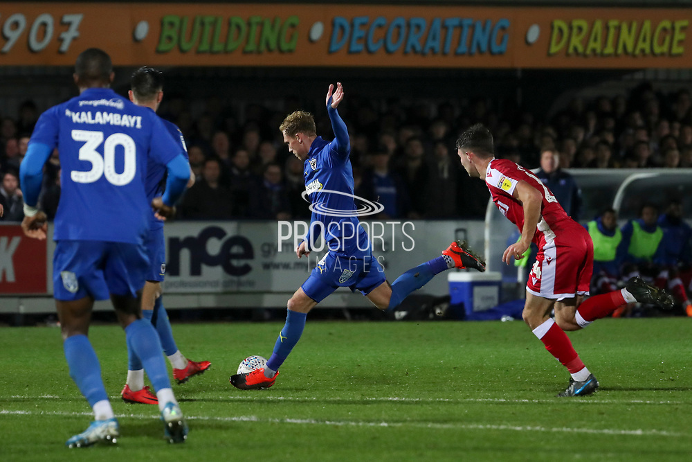 AFC Wimbledon midfielder Mitchell (Mitch) Pinnock (11) with a shot on goal during the EFL Sky Bet League 1 match between AFC Wimbledon and Gillingham at the Cherry Red Records Stadium, Kingston, England on 23 November 2019.