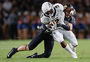 WEST LAFAYETTE, IN - SEPTEMBER 15: Jalen Knox #9 of the Missouri Tigers runs the ball as Jacob Thieneman #41 of the Purdue Boilermakers makes the tackle from behind during the first half of the game at Ross-Ade Stadium on September 15, 2018 in West Lafayette, Indiana. (Photo by Michael Hickey/Getty Images) *** Local Caption *** Jalen Knox; Jacob Thieneman NCAA Football - Purdue Boilermakers vs Missouri Tigers at Ross-Ade Stadium in West Lafayette, Indiana. Sports photographer by Michael Hickey