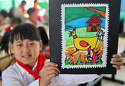 October 8, 2018 - Qinhuangdao, Qinhuangdao, China - Qinhuangdao, CHINA-Pupils draw creative paintings of stamps at a primary school in Qinhuangdao, north China's Hebei Province, marking World Post Day. (Credit Image: © SIPA Asia via ZUMA Wire)