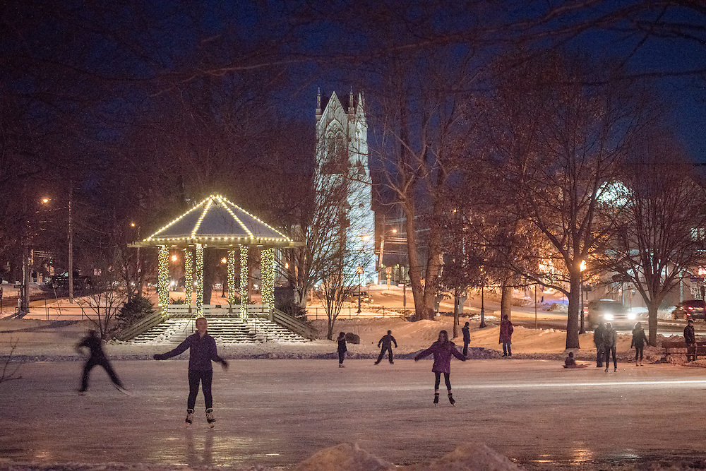 This classic Brunswick scene is one of my favorites. A large group of people, kids and adults, skate across the ice on the mall in the center of downtown Brunswick. In the background, the gazebo and First Parish Church are illuminated.