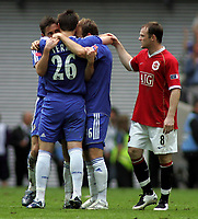 Photo: Paul Thomas.<br /> Chelsea v Manchester United. The FA Cup Final. 19/05/2007.<br /> <br /> Dejected Wayne Rooney of Utd congratulates John Terry (26), Frank Lampard (L) and Arjen Robben.