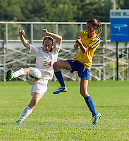 Laconia's Rebecca Howe and Kearsarge's Taryn Hubley try to gain control of the ball during NHIAA Division III soccer at Robbie Mills Field Wednesday afternoon.  (Karen Bobotas/for the Laconia Daily Sun)