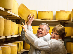 Scottish Lib Dem leader Willie Rennie gets to grips with one of the cheeses along with local candidate Elizabeth Richef when he visited St Andrews Farmhouse Cheese Company in Pitenweem in Fife in the run up to the 2017 General Election.<br /> <br /> &copy; Dave Johnston/ EEm