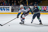 KELOWNA, CANADA - FEBRUARY 13: Elijah Brown #11 of the Seattle Thunderbirds back checks Devante Stephens #21 of the Kelowna Rockets on February 13, 2017 at Prospera Place in Kelowna, British Columbia, Canada.  (Photo by Marissa Baecker/Shoot the Breeze)  *** Local Caption ***