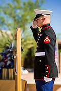 08 OCTOBER 2013 - PHOENIX, AZ: A US Marine stands at attention at a ceremony interring the cremated remains of unclaimed US military veterans at the National Memorial Cemetery in Phoenix. The cremated remains of 36 unclaimed US military veterans were interred at the National Memorial Cemetery in Phoenix. Members of the US military and several hundred veterans of the US military attended the service, which was a part of the Missing In America Project (MIAP).     PHOTO BY JACK KURTZ