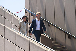 AU_1369901 - Sydney, AUSTRALIA  -  Prince Harry and Meghan tour Opera House, Taronga Zoo after baby news. Royal watchers swamp Opera House for Meghan Markle and Prince Harry's first day on tour downunder.<br /> <br /> Pictured: Prince Harry and Meghan Markle<br /> <br /> BACKGRID Australia 16 OCTOBER 2018 <br /> <br /> BYLINE MUST READ: Trevor Goddard / BACKGRID<br /> <br /> Phone: + 61 2 8719 0598<br /> Email:  photos@backgrid.com.au