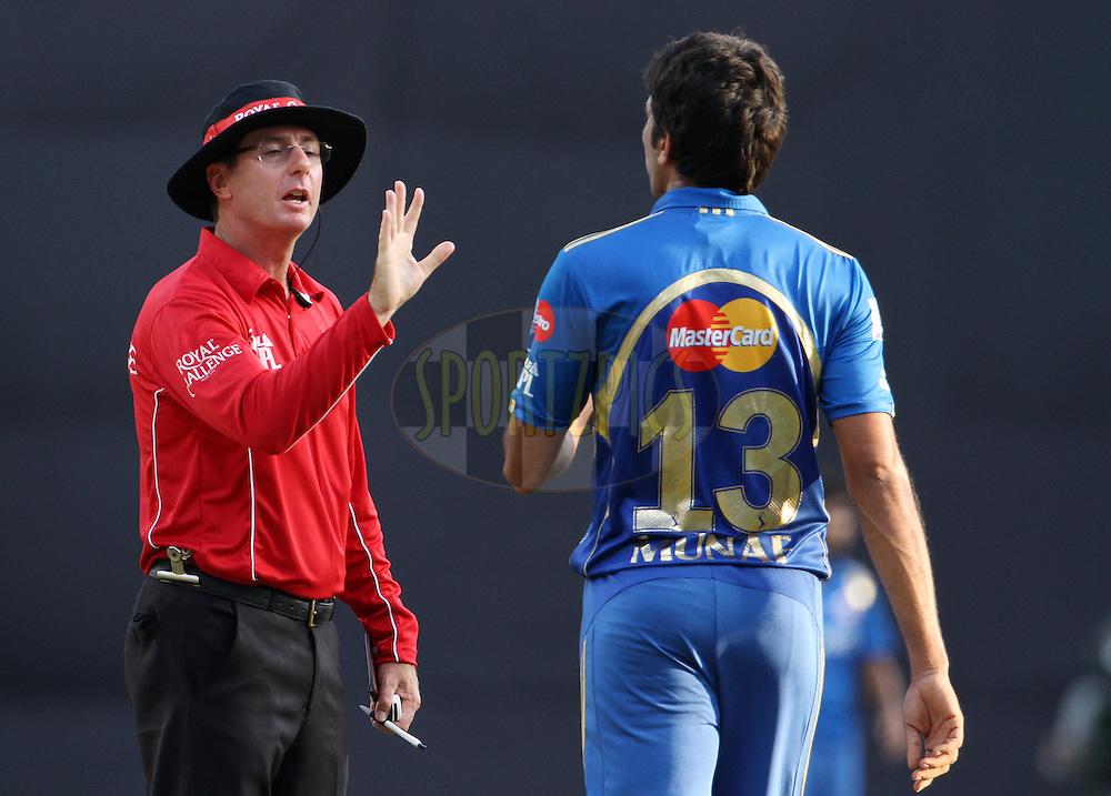Umpire RJ Tucker warns Mumbai Indian player Munaf Patel during match 28 of the Indian Premier League ( IPL) 2012  between The Mumbai Indians and the Kings X1 Punjab held at the Wankhede Stadium in Mumbai on the 22nd April 2012..Photo by: Vipin Pawar/IPL/SPORTZPICS