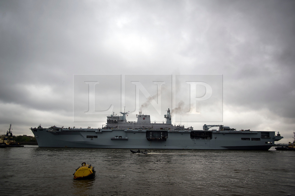 © London News Pictures. 04/05/2012. London, UK. Royal Navy helicopter carrier HMS Ocean passing woolwich pier towards Greenwich for an Olympics security exercise as part of operation Olympic Guardian on May 4, 2012. The ship will be berthed at Greenwich throughout the Olympics, acting as logistic hub and helicopter launch platform. Photo credit: Ben Cawthra/LNP